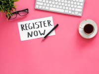 keyboard, coffee cup, eyeglasses, memo with Register Now